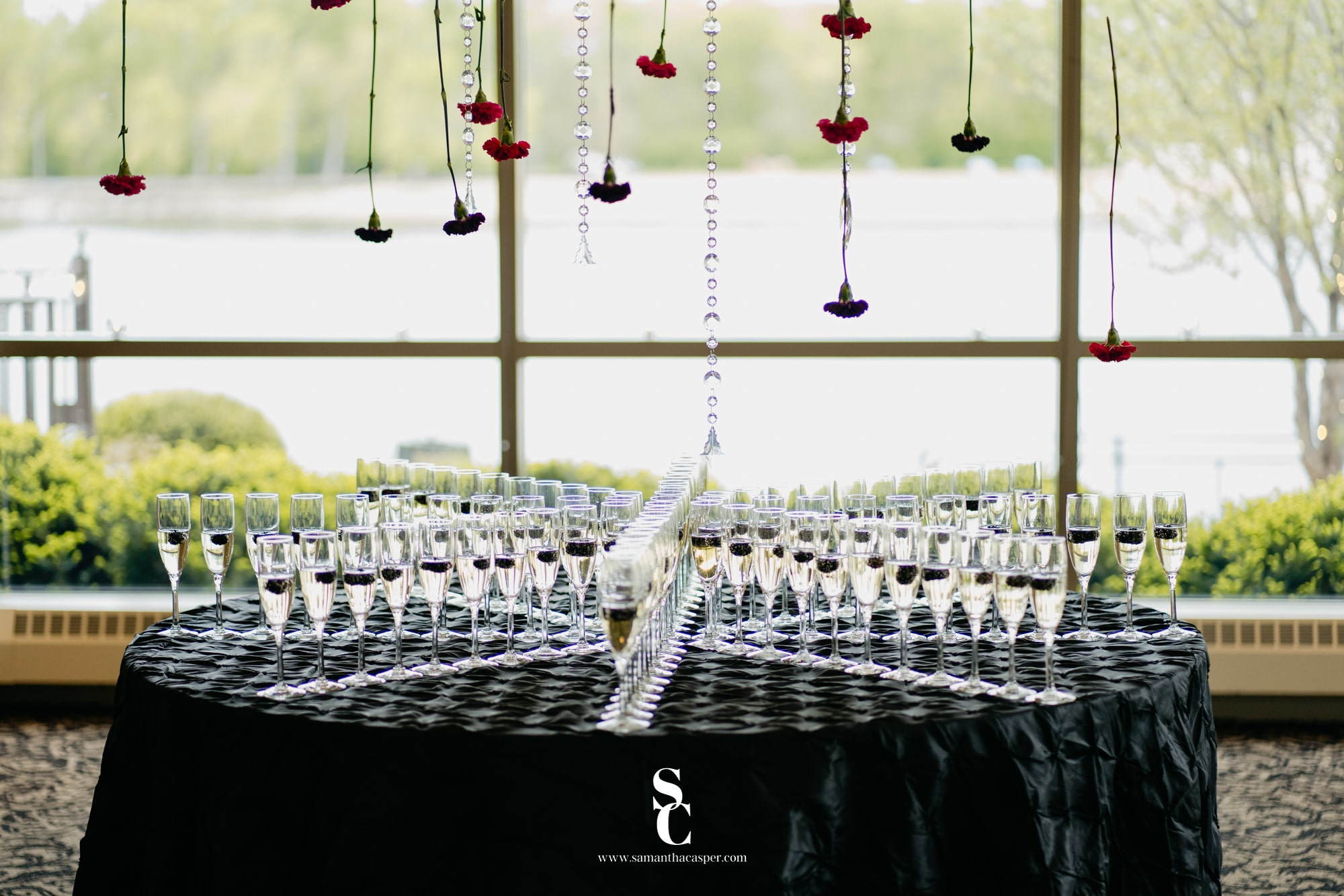 champagne table with flowers and crystals hanging